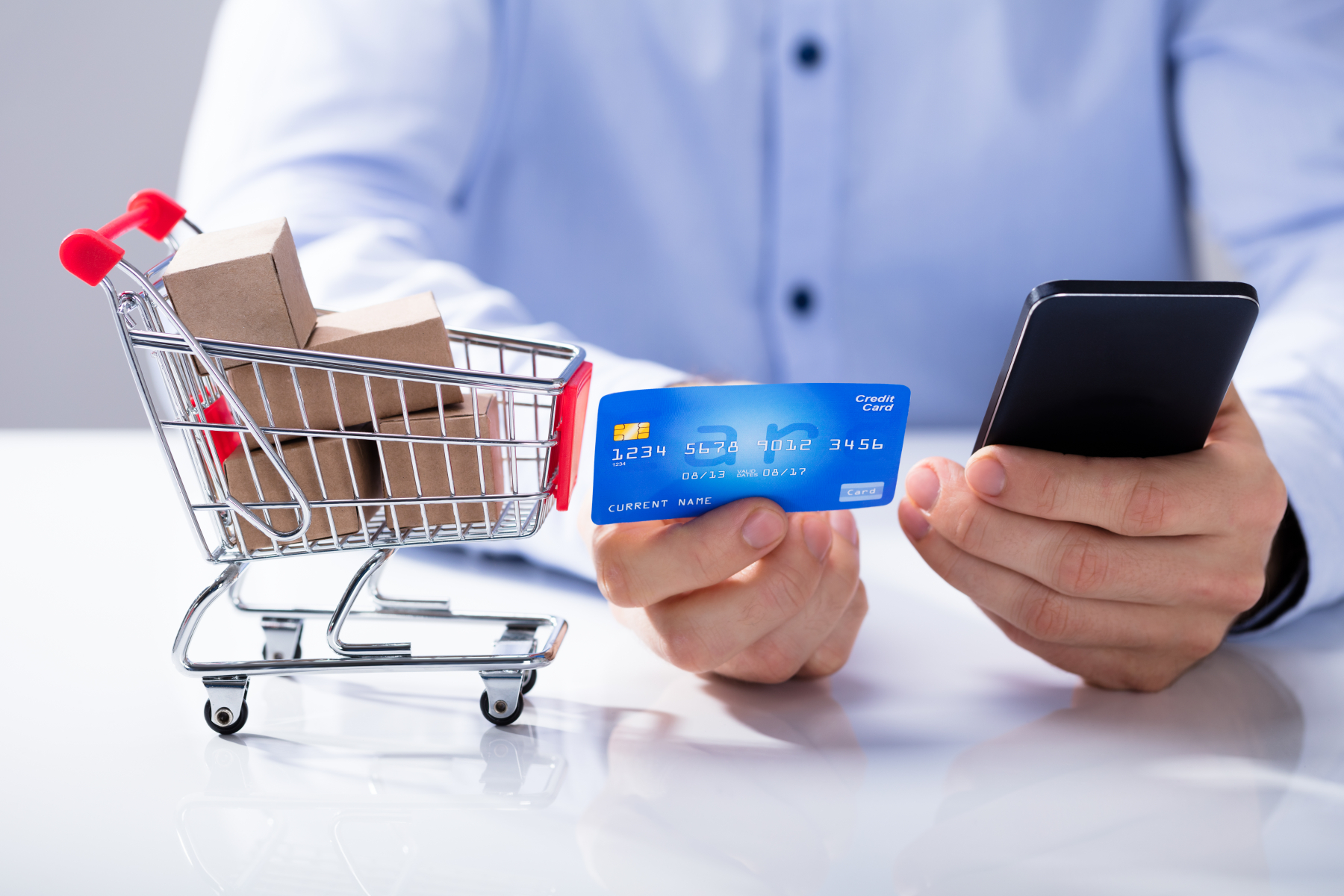 24195170-man-use-credit-card-for-shopping-online-by-smart-phone